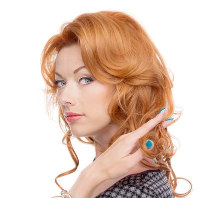 sholders: Headshot of a redhead in a grey dress.