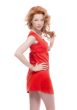 sholders: Sideshot of a redhead in a red dress