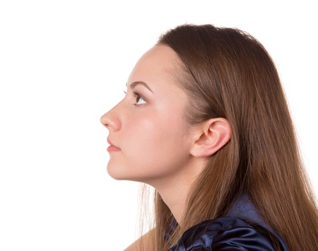 sholders: Profile headshot of a brown hair lady