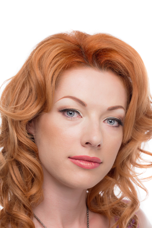 sholders: Headshot of a redhead lady looking forward Stock Photo