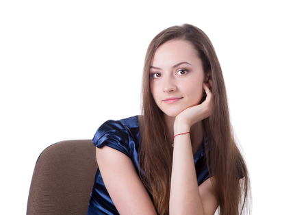 sholders: Headshot of a brown hair lady sitting in a chair.