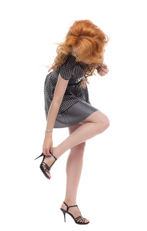 jewlery: Fulllength shot of a redhead in a grey dress Stock Photo