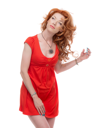sholders: Redhead in a red dress looking upwards. Stock Photo