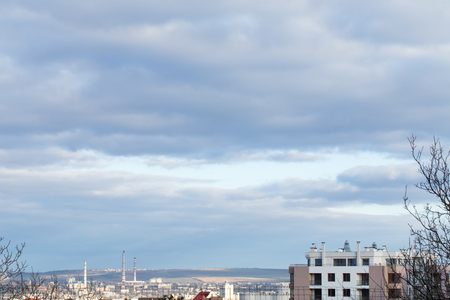 highriser: City view with cloudy sky.  Photo can be used as a whole background. Stock Photo