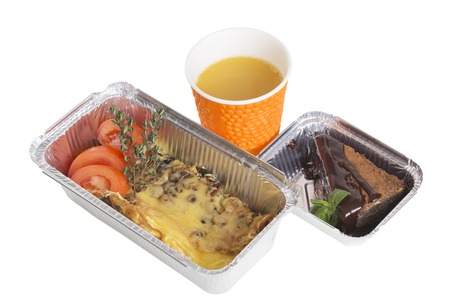 Omelet and dessert in takeaway containers. Isolated on a white background.