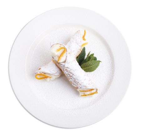Sicilian cannoli with ricotta. Isolated on a white background.