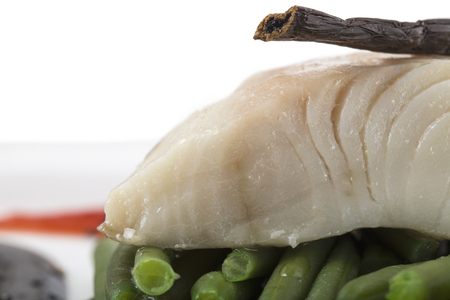 Steamed trout fillet with french beans. Macro. Photo can be used as a whole background.