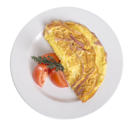 Omelet with ham and tomatoes. Isolated on a white background.