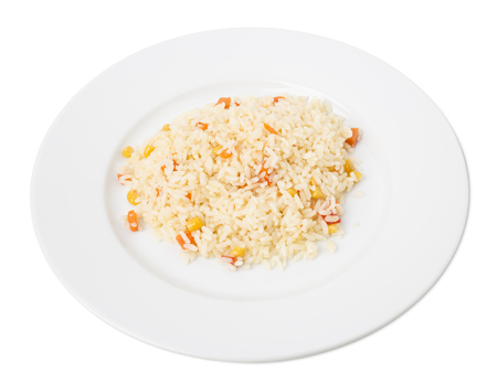 Delicious rice with vegetables. Isolated on a white background. Stock Photo