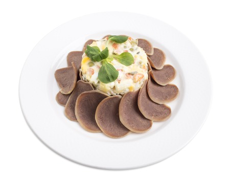 ensaladilla rusa: Russian salad with beef tongue.   Isolated on a white background. Foto de archivo