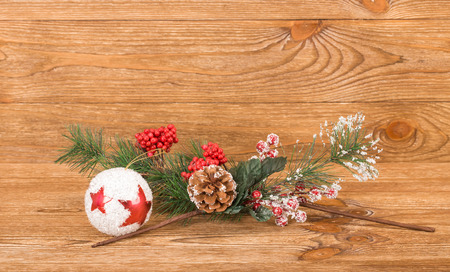 Christmas-tree decorations. Located on a wooden background. Stock Photo