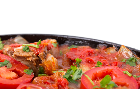 georgian: Stewed beef loin with tomatoes and onions. Macro. Photo can be used as a whole background. Stock Photo