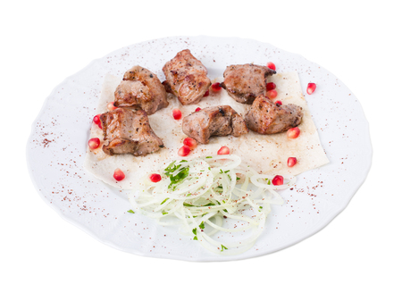 flavouring: Delicious beef shish kebab on pita with onions and pomegranate seeds. Isolated on a white background.