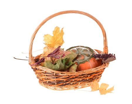 spliced: Composition of a pumpkin at the basket. Isolated on the white background. Stock Photo