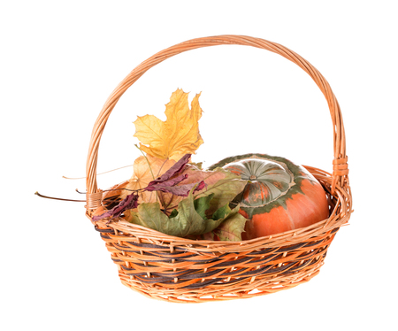 Composition of a pumpkin at the basket. Isolated on the white background. Stock Photo