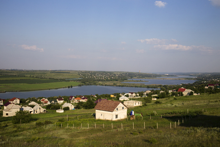 Magnificent rural landscape. Landscape with a village and a lake. Stock Photo