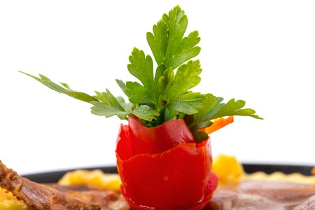 steel pan: Tomato and parsley on chicken tabaka. Macro. Photo can be used as a whole background. Foto de archivo