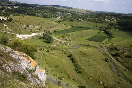 View between the hills. Picturesque village located between the hills. Stock Photo