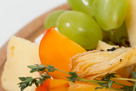 Cheese platter closeup. Delicious croutons and mango. Macro. Photo can be used as a whole background. Stock Photo