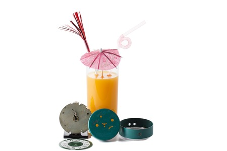 While drinking juice. There are an alarm clock and a glass of juice.