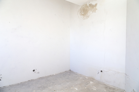 Room before repair. Stains on the wall from the water. Stock Photo