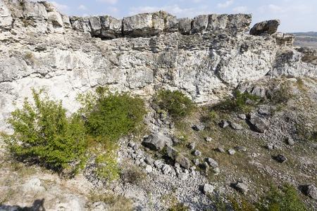 Abandoned limestone quarry located in the north of the Republic of Moldova. Banco de Imagens - 88329991