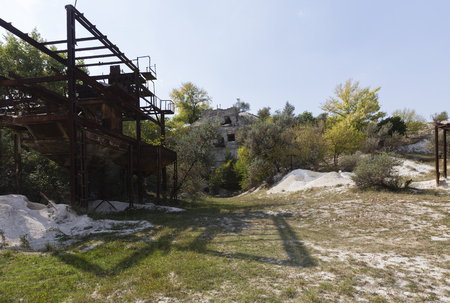 Industrial landscape and nature. Abandoned chalk mine and ruins.