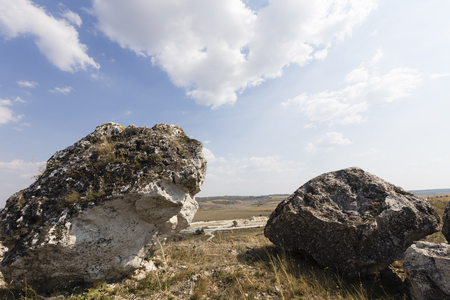 Couple of huge rocks. Huge rocks are close up on the sky background. Banco de Imagens - 88330046