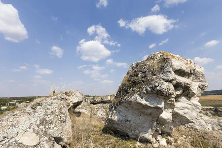 Lonely huge rocks. Huge rock is close up on the sky background. Banco de Imagens - 88330102