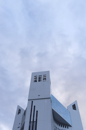Top of the building. The building composed of three tower block. Stock Photo