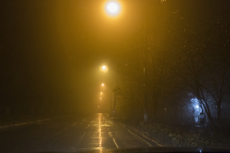 Mist and Night. Street lamps and the mist at the night. Blurred view. Stock Photo