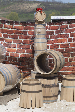 Wooden big barrels. Brick wall on the background.