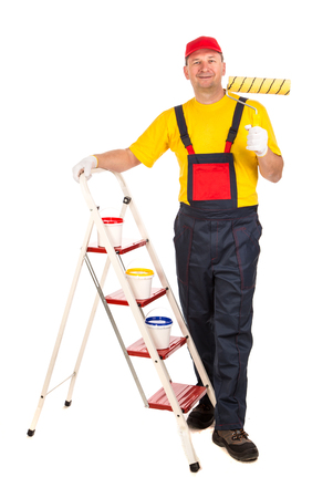 Male model is showed as a house painter. It is isolated in a white background.