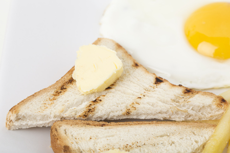 Fragmnet of breakfast with toast and egg. Close-up. Banco de Imagens