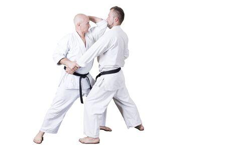 Adult athlete performs formal goju-ryu exercises