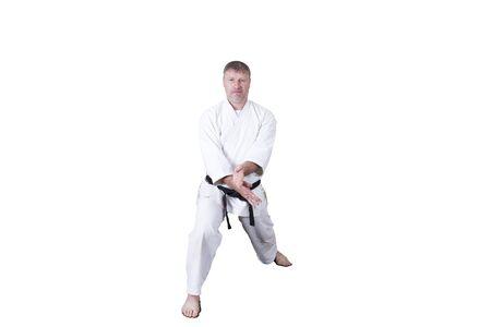 Adult athlete performs formal goju-ryu exercises Stock fotó
