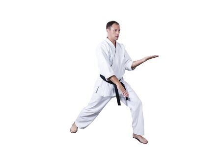Adult athlete performs formal goju-ryu exercises.