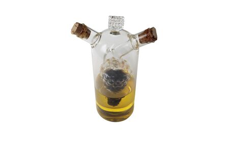 Double glass bottle with grape shape inside and two wood bungs. Isolated in a white background. Close-up.