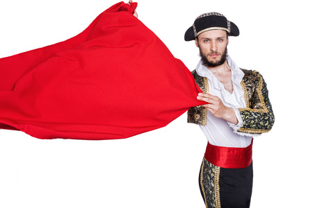 Matador throw a red cape  Studio portrait isolated on a white background   스톡 콘텐츠