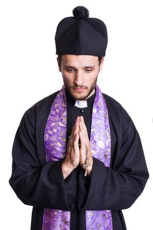 Praying priest. Studio portrait isolated on white background   photo