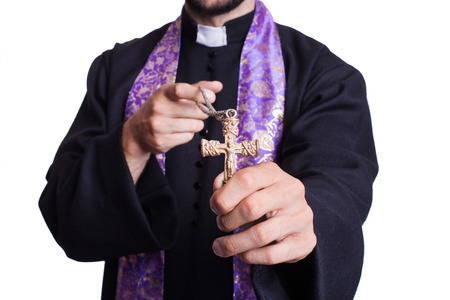 priesthood: Concept: Christianity. Studio shot isolated on white background   Stock Photo
