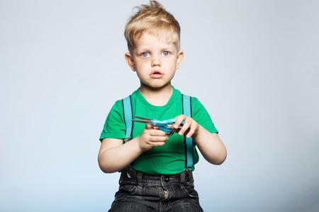 Naughty little boy with scissors photo
