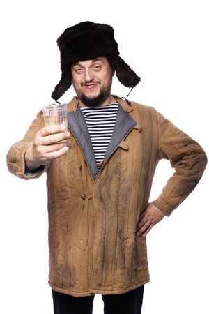 Happy russian man offering a vodka, cheers. Studio portrait isolated on white background  스톡 콘텐츠