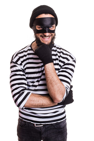 crafty: Crafty robber smiling and thinking. Portrait isolated on white background Stock Photo