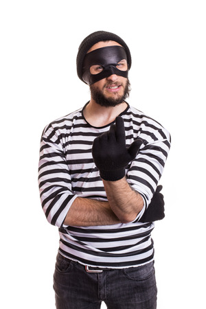 furtive: Crafty criminal inviting with hand. Portrait isolated on white background Stock Photo