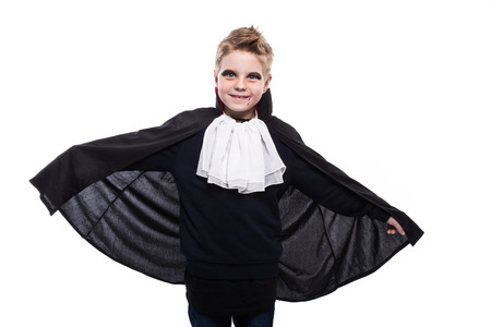 Cute boy dressed up as vampire for the halloween party isolated over white background 스톡 콘텐츠
