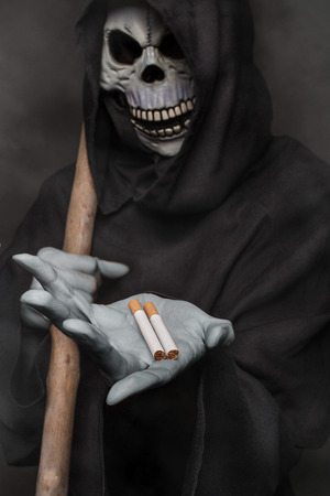 the kills: The concept: smoking kills. Angel of death holding cigarette