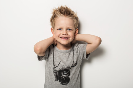 Portrait of cute little boy posing. Studio portrait over white background