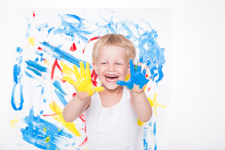 Portrait of a little messy kid painter. School. Preschool. Education. Creativity. Studio portrait over white background
