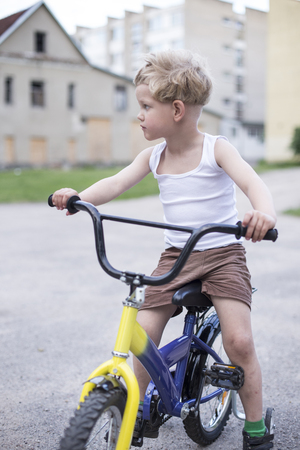 road cycling: Child on a bicycle at asphalt road. Childhood. Sport. Cycling